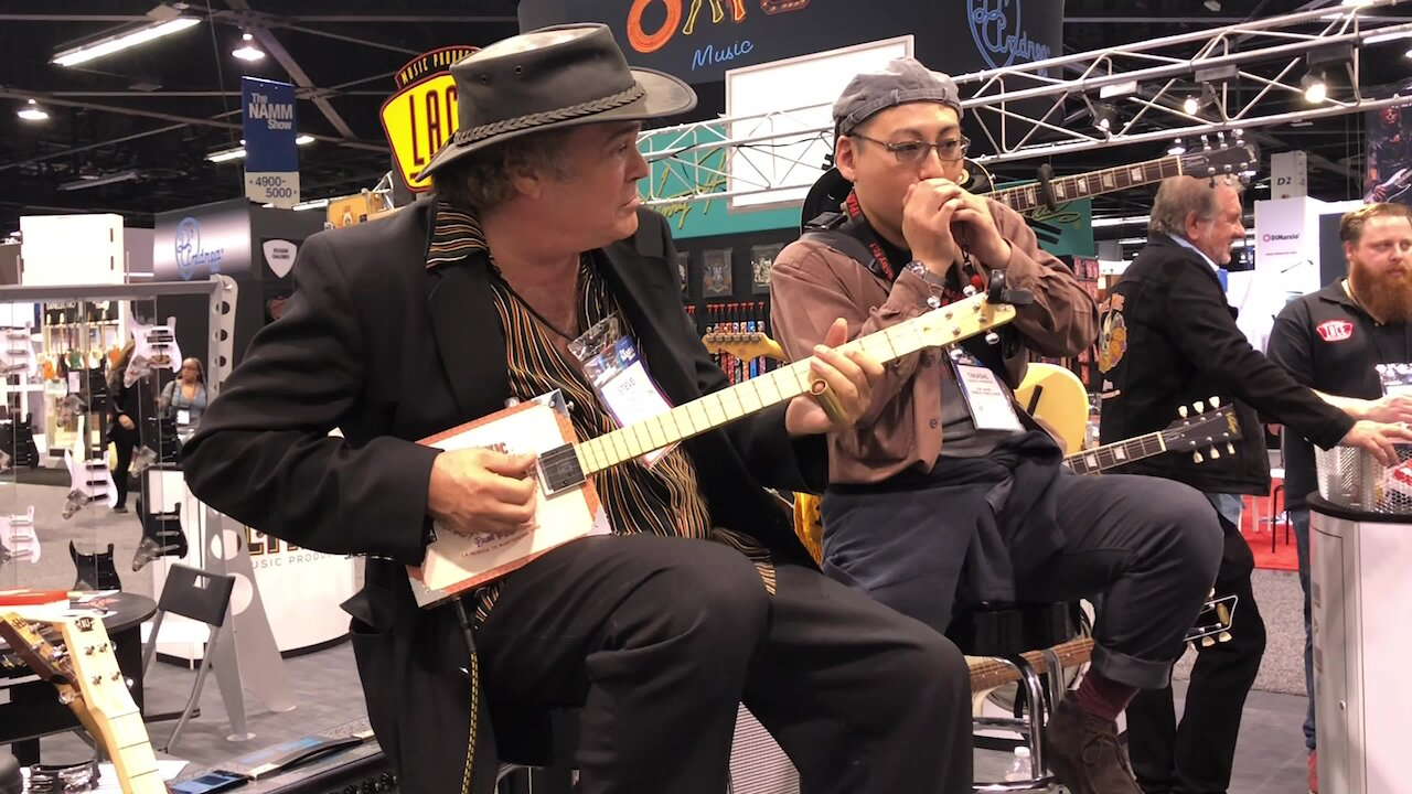 Video poster Music Is A Universal Language Jamming the Blues at The 2020 NAMM Show In Anaheim California With A Cigar Box Guitar